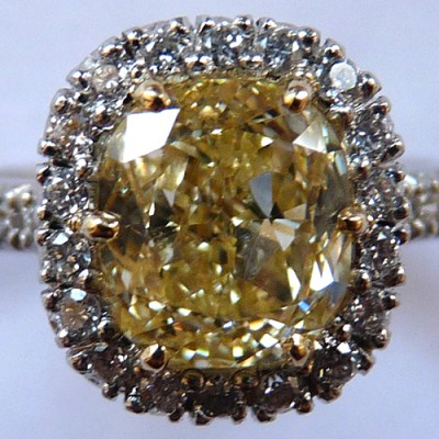 Diamond, Platinum and Eighteen Karat Yellow Gold Ring